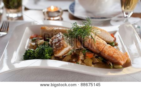 Salmon fillet dish with fresh vegetables