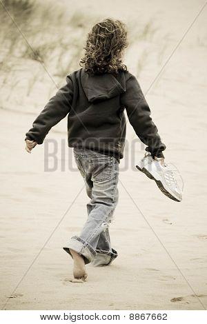 Young Girl Walks On Beach