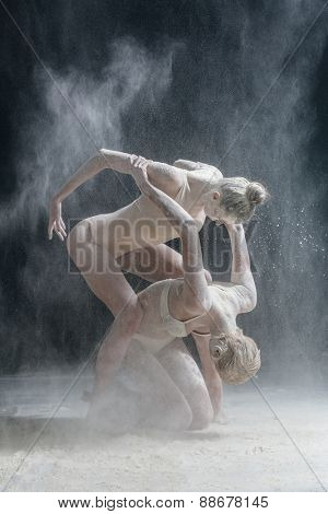 female dancer dirty in white flour