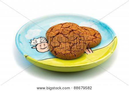 Smiling Sheep Underneath Cookies On A Colorful Plate
