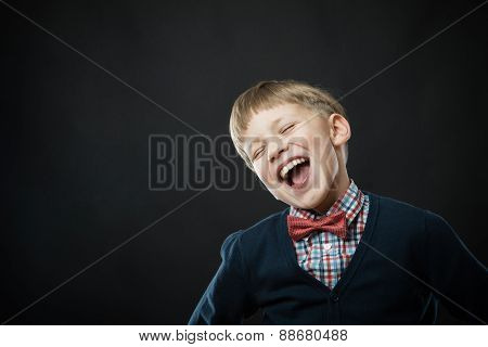Close Up Portrait Of Young Laughing Cute Boy