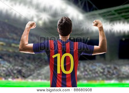 Soccer player on red and blue t-shirt in the stadium