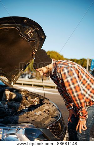 Man Looking At Broken Old New Rental Car Vehicle Engine And Try To Find Problem At Repair Fix