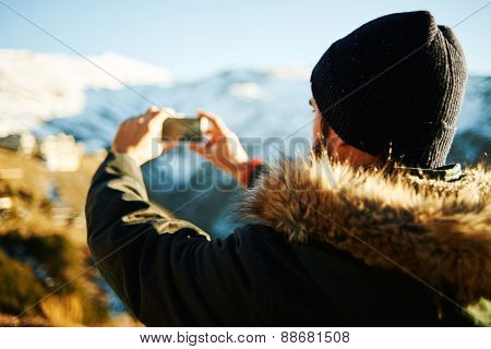 Happy Man Taking Selfie Self-portrait Photo Hiking. Hikers Holding Camera And Take A Shot Of Himself