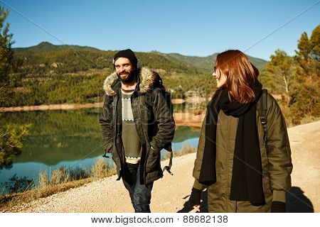 Hiking. Hiker Couple Portrait In Sunny Day. Hikers Walking In Mountain Forest During Camping Travel