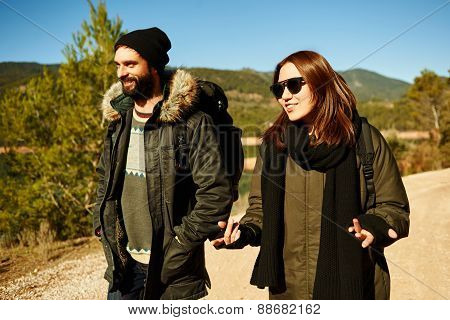 Couple Hiking. Young Hikers Smiling Happy Walking In Mountain Forest During Camping Travel.
