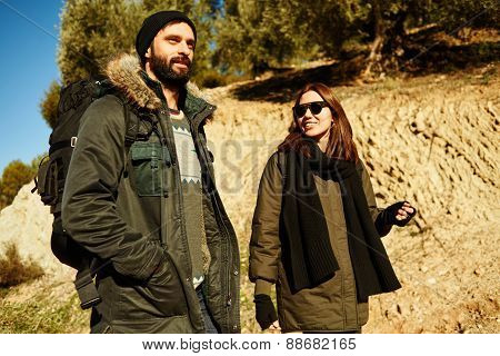 Travelers Couple Portrait. Hikers Walking In Mountain Forest During Camping Travel Hike. Healthy Lif