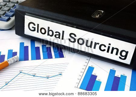 File folder with global sourcing and financial graphs.