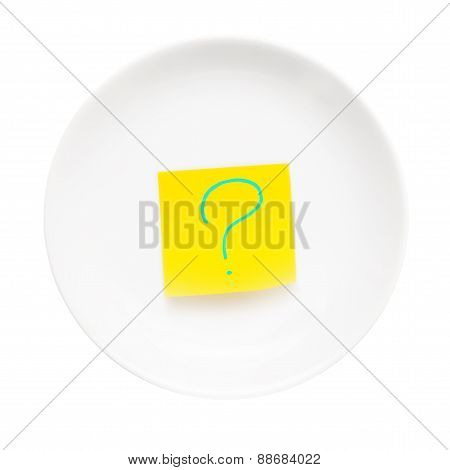 White plate with stick note