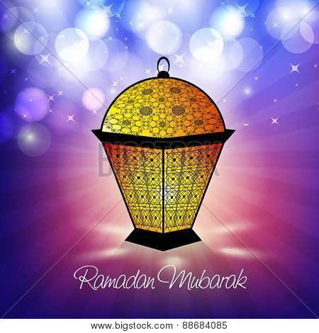 Illuminated traditional arabic lamp or lantern on shiny colorful background for holy month of muslim community, Ramadan Kareem celebration.