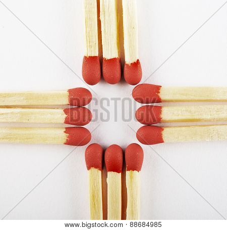 Close Up Of Matches, Arranged Three On Cross