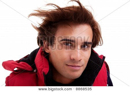 Portrait Of A Young Man With Hair On The Wind , In Autumn/winter Clothes, Isolated On White. Studio