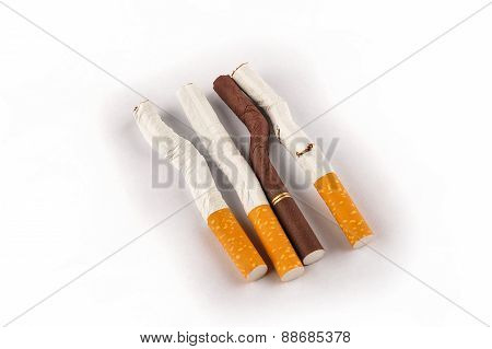 Bent And Broken Cigarettes On A White Background