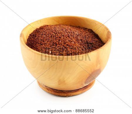 Ground coffee in small dish isolated on white