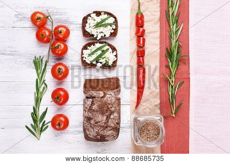 Bread with cottage cheese, greens and tomatoes on table top view