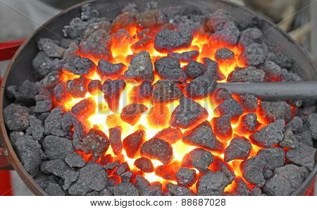 Hot Ingot Iron Working In The Workshop Of Blacksmith