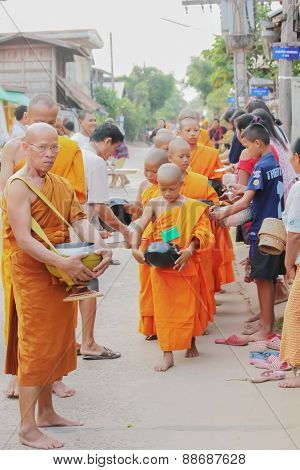 Monks Collecting Alms Around The Village
