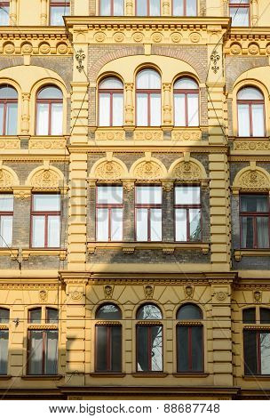 Yellow facade of old residential building on Jindrisska Street 875/23 in Prague, Czech Republic.