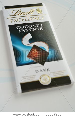 NOVOSIBIRSK, RUSSIA - NOVEMBER 15, 2014: Chocolate bar Lindt Excellence coconut intense dark on white background. Founded in 1845 in Switzerland, now Lindt & Sprungli group has sites in 6 countries