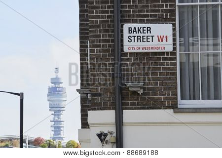 LONDON, UK - APRIL 22: Baker Street sign on brick wall, with famous BT tower in the background. April 22, 2015 in London.