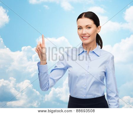 business, technology and people concept - businesswoman pointing finger to or touching something imaginary over blue sky and clouds background