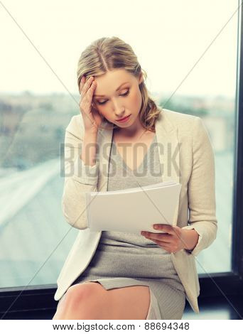 indoor picture of bored and tired woman with documents