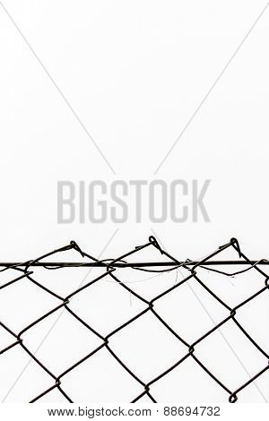 chain link fence in front of white background, symbol of frontier, network, open space