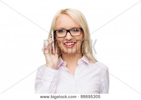 business, style and people concept - smiling businesswoman, student or secretary calling on smartphone over white background