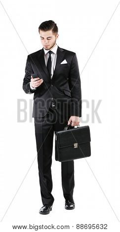 Elegant man in suit with mobile phone and briefcase isolated on white
