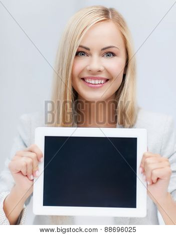picture of smiling woman showing tablet pc display