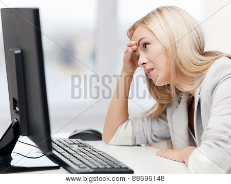 picture of stressed businesswoman with computer at work