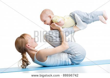 Yoga for woman and baby. Mother with child boy doing fitness exercises
