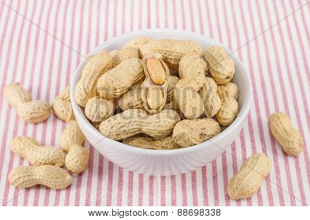 Closeup Of Salted Groundnuts In White Bowl