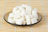 pic of sugar cube  - The sugar cubes on a plate standing on bambo napkin