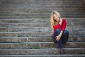 pic of straight jacket  - Young beautiful blonde woman with long straight hair and gray - JPG