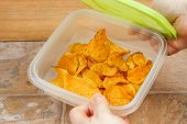 pic of potato chips  - Sweet potato chips stored in an air tight container - JPG