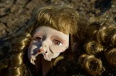picture of forlorn  - Broken head of porcelain doll lying on the ground - JPG