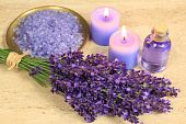 stock photo of lavender field  - Spa composition - lavender flowers coloured bathing salt and candles