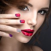 foto of nail-design  - Beautiful girl with a bright evening make - JPG