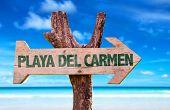 stock photo of playa del carmen  - Playa Del Carmen wooden sign with beach background - JPG