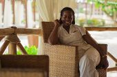 picture of receptionist  - Smiling stylish beautiful receptionist handing at the beach - JPG