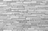 picture of stonewalled  - Texture and seamless background of white granite stone block wall - JPG