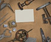 picture of work bench  - vintage jeweler tools and diamonds over working bench blank business card for your text - JPG