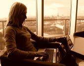 picture of 24th  - beautiful woman working on 24th floor with wireless network  - JPG