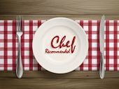 stock photo of recommendation  - top view of chef recommended words written by ketchup on a plate over wooden table - JPG