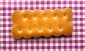 foto of lilas  - Fresh cookies on lila checked background closeup - JPG