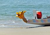 stock photo of dragon head  - Front head of a dragon boat on a beach - JPG