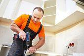 picture of carpenter  - Craftsman kitchen carpenter at kitchen furniture set installation service work - JPG
