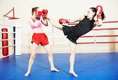 stock photo of boxing ring  - muai thai women fighting at training boxing ring - JPG