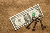 pic of hasp  - US dollar banknotes and old keys on an old cloth - JPG